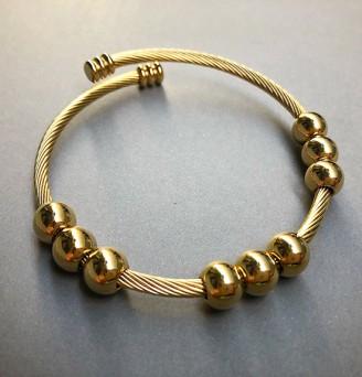 Nine Spheres Cable Bangle in Gold Tone